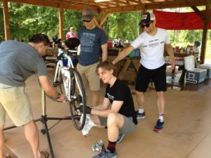 Members of L5Flyers Cycling Team provide moral and mechanical support at the Rutledge Pit Stop